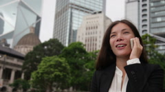 Business people - asian businesswoman on smart phon in Hong Kong Stock Footage