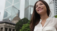 Business woman walking casual outdoor in Hong Kong -  Asian businessperson - stock footage