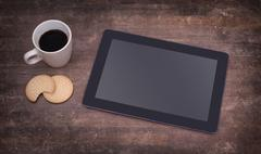 Stock Photo of tablet touch computer gadget on wooden table