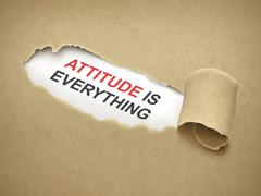 attitude is everything words behind torn paper - stock illustration