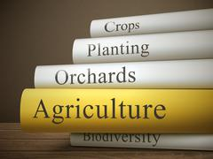 book title of agriculture isolated on a wooden table - stock illustration