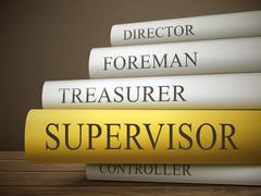 Stock Illustration of book title of supervisor isolated on a wooden table