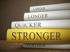 Book title of stronger isolated on a wooden table Stock Illustration
