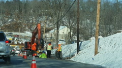 2713 Construction Workers doing Road Work During Winter in Slow Motion Stock Footage