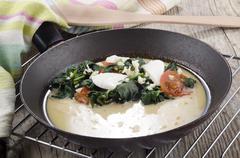 prepare omelette in a pan - stock photo