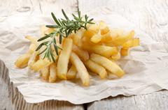 French fries with fresh rosemary Stock Photos