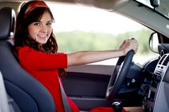 happy smiling woman driving car - stock photo
