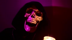 Hooded skeleton thing creepy weird Stock Footage