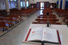 Holy bible in the christian church the lectern Stock Photos
