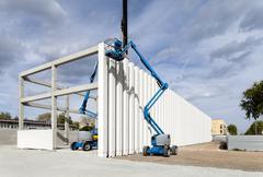 building under construction. columns. cranes - stock photo