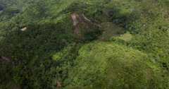 Aerial of damages to Chocolate Hills due to earthquake Stock Footage