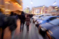 busy city people going along the street - stock photo