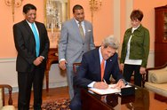 Secretary Kerry Signs the Appointment Papers for Assistant Secretary Rose Stock Photos