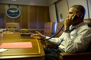 President Barack Obama talks on the phone with French President Francois Holl Stock Photos