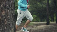 Joggers feet running in forest, slow motion shot at 240fps   HD Stock Footage