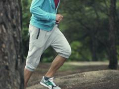 Joggers feet running in forest, slow motion shot at 240fps   NTSC Stock Footage