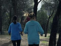 Young people jogging in park, slow motion shot at 240fps NTSC Stock Footage