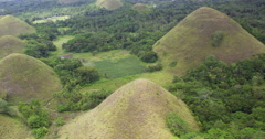 Aerial of nearby Chocolate Hills karst landscape Stock Footage