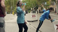 Young people stretching, drinking and jogging in city, slow motion shot at 24 HD Stock Footage