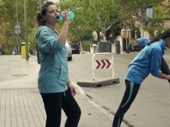 Young people stretching, drinking and jogging in city, slow motion shot at  NTSC Stock Footage