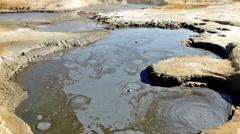 Boiling mud pool Stock Footage