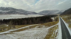 4K Aerial Footage Flight Above Higway in Winter Mountains Stock Footage