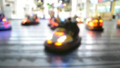 Blurred motion of people driving bumper cars Stock Footage