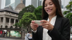 Asian business woman on smartphone in Hong Kong - young female professional Stock Footage