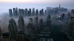 Aerial view skyscraper foggy weather Dubai Marina at morning Stock Footage