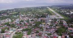 Aerial of coastal runway of an airport Stock Footage