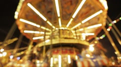 Beautiful spinning carousel in the Park (Out of focus) Stock Footage