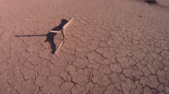 Sunset Shadow on Dry Desert Lake Bed - stock footage