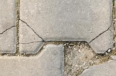 Crackled stone pave with dirt, concrete path texture. Stock Photos