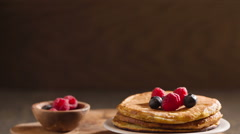 Tasty homemade pancakes with berries and maple syrup Stock Footage