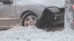 Police investigate car accident scene in snow storm Stock Footage