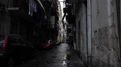Naples Italy narrow alley street neighborhood rain people 4K 077 Stock Footage