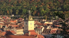 ULTRA HD 4K Aerial view Brasov Ancient City Hall Tower sunlight Sfatului Square  Stock Footage