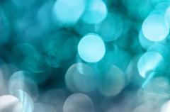 Light blue circle christmas lights as blur background. Kuvituskuvat