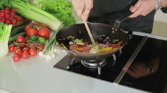 Frying in a wok Stock Footage
