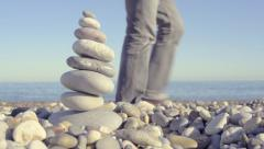 Stack of Pebbles on Beach - stock footage