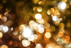 blur golden circle lights as christmas background. - stock photo