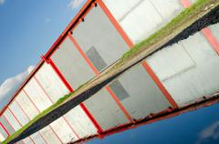 A lot of garages, puddle with reflection. Stock Photos