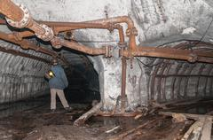tunnel to the dark from a coal mine - stock photo