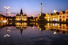 town square at night and reflection in the water. - stock photo