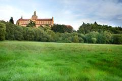 Stock Photo of baroque monastery at the top of small hill.