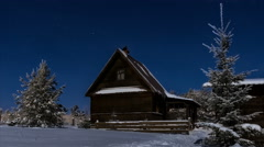 Timelapse 4K of stars over timber house at winter night then clouds coming - stock footage