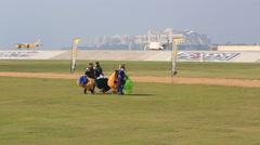 Parachutist walk landing area Stock Footage
