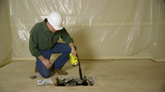 construction foreman inspecting a slab leveling job - stock footage