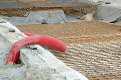 Street repairing, metal bolter and red pipe. Stock Photos