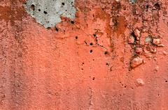 Orange black white painted chappy wall texture background. Stock Photos